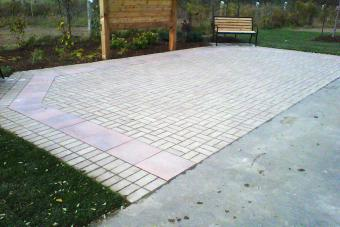 Patio in park made with interlocking pavers.