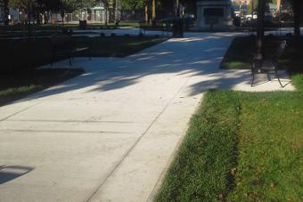 New concrete pathway in park.