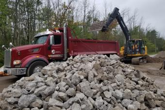Stones for culvert installation.
