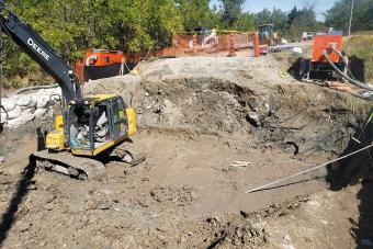 Creek diversion and box culvert installation.