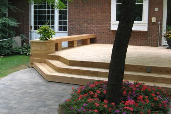 Custom wood deck with paver patio.
