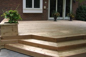 Custom wood deck with built-in planter box.