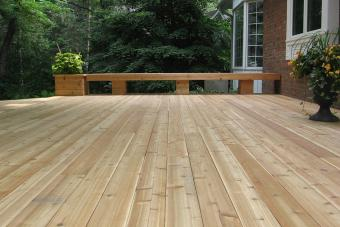 Custom wood deck with built-in planter box and bench.