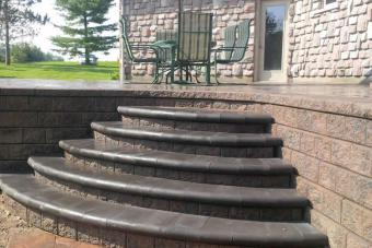 Stone retaiing wall and new round steps.