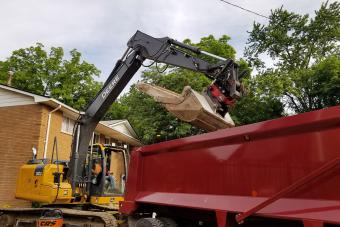 Loading broken concrete into a dump truck.